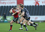 Munster centre Denis Hurley takes on Ospreys pair Ben John and Jonathan Spratt.<br /> Guiness Pro12<br /> Ospreys v Munster<br /> Liberty Stadium<br /> 07.03.15<br /> ©Steve Pope - SPORTINGWALES
