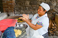 Beautiful local woman making tortillas at over in La Posada de Don Rodrigo restaurant in Antigua Guatemal