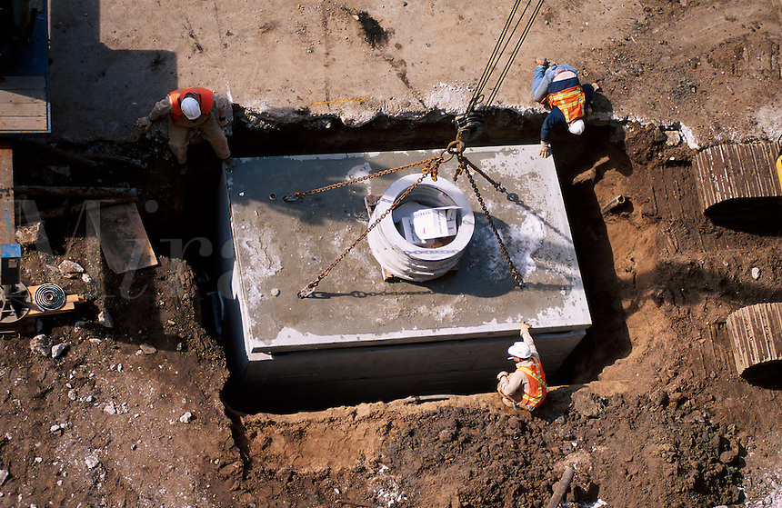 workers installing a septic tank.