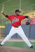 Oliver Garcia #20 of the High Desert Mavericks pitches against the Modesto Nuts at Heritage Field on June 29, 2014 in Adelanto, California. High Desert defeated Modesto, 6-1. (Larry Goren/Four Seam Images)