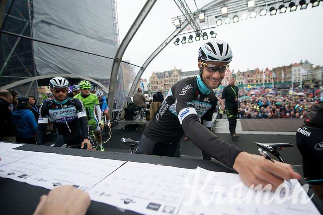 Tripple Ronde winner Tom Boonen (BEL/OPQS) signing in on the start podium in Bruges<br /> <br /> Ronde van Vlaanderen 2014