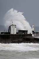 Pictured: Waves hit the lighthouse in Porthcawl, Wales, UK. Friday 25 October 2019<br /> Re: Heavy rain has been affecting most parts of Wales and is likely to bring flooding, disruption to public transport and roads and power cuts, according to the Met Office.