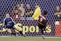 The Crew's goalkeeper Matt Jordan guesses wrong on the MetroStars' Sergio Galvan Rey's penalty shot in the 71st minute. The Columbus Crew and the MetroStars played to a 1-1 tie in regular season MLS action on Saturday October 9, 2004 at Giant's Stadium, East Rutherford, NJ..