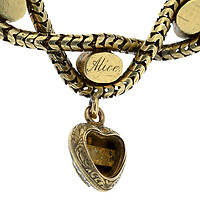 BNPS.co.uk (01202 558833)<br /> Pic: Fellows/BNPS<br /> <br /> Pictured: 'Alice' engraved on the locket.<br /> <br /> A poignant bracelet that belonged to Queen Victoria and still contains a lock of her daughter's hair has sold for almost £4000.<br /> <br /> The extraordinary piece of jewellery has five lockets attached to it and each would have held strands of hair of her children at the time.<br /> <br /> She had the names of Princesses Victoria, Alice, Louise and Helena and Prince Alfred engraved on the bracelet.