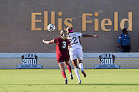 Texas A&M forward Bianca Brinson (22) and South Carolina defender Caroline Gray (3) go after the ball during NCAA soccer game, Sunday, October 26, 2014 in College Station, Tex. South Carolina draw 2-2 against Texas A&M in double overtime. (Mo Khursheed/TFV Media via AP Images)