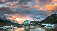 Colourful sunset over Tasman Glacier and its lake with icebergs, Aoraki Mount Cook National Park, UNESCO World Heritage Area, Mackenzie Country, New Zealand, NZ