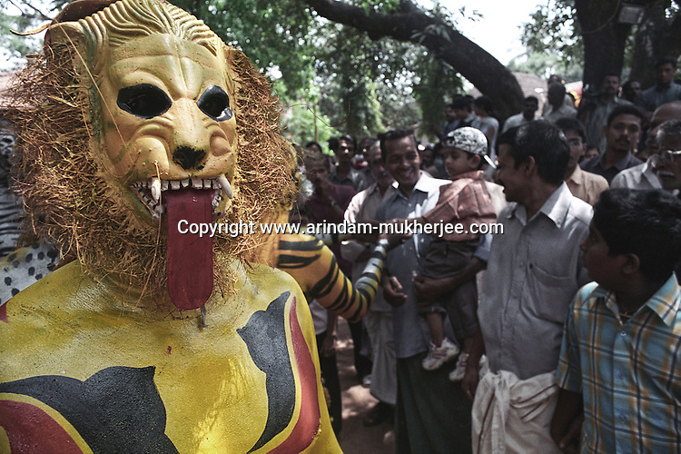 A Pulikali (the tiger festival) performer waits before his performance.