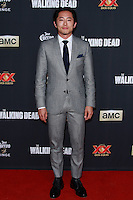 UNIVERSAL CITY, CA, USA - OCTOBER 02: Steven Yeun arrives at the Los Angeles Premiere Of AMC's 'The Walking Dead' Season 5 held at AMC Universal City Walk on October 2, 2014 in Universal City, California, United States. (Photo by David Acosta/Celebrity Monitor)