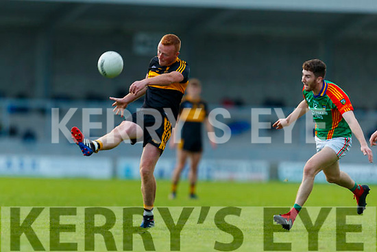 Johnny Buckley, Dr. Crokes in action against Ciaran Kennedy, Mid Kerry during the Kerry County Senior Football Championship Semi-Final match between Mid Kerry and Dr Crokes at Austin Stack Park in Tralee, Kerry.