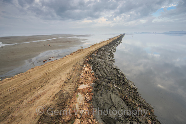 Dike construction behind the 33 km long Saemangeum Seawall. This used to be  one of the most productive estuarine systems in the Yellow Sea and was critical migratory stopover habitat for the Spoon-billed Sandpiper and other migratory bird species. Saemangeum, South Korea. October.