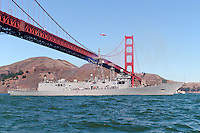 With a Coast Guard HH-65 Dolphin flying above the USS Vandergrift (FFG 48) passes under the Golden Gate Bridge as it leads the Parade of Ships into San Francisco Bay during the 2007 San Francisco Fleet Week. The USS VANDEGRIFT (FFG 48) was named for Gen. Alexander A. Vandegrift, U.S. Marine Corps, and built at Todd Pacific Shipyards in Seattle, Washington. The ship was commissioned on November 24, 1984. In March of 1990 the Vandergrift patrolled he Northern Arabian Gulf and conducted Earnest Will escort missions and served as the Anti-Air Warfare Commander and Electronic Warfare Coordinator.