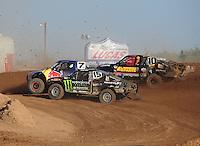 Apr 17, 2011; Surprise, AZ USA; LOORRS driver Marty Hart (15) , Bryce Menzies (7) and Greg Adler (10) during round 4 at Speedworld Off Road Park. Mandatory Credit: Mark J. Rebilas-
