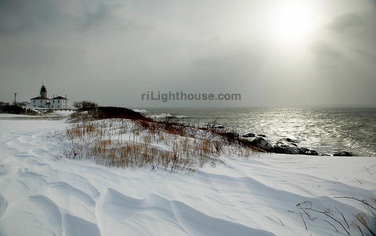 Beavertail Lighthouse on Jamestown, covered in fresh snow.