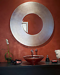 Contemporary Half Bath with Red Faux Finished Walls, Round Metal Framed Mirror, and Black vanity with vessel sink