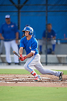 Toronto Blue Jays left fielder Brandon Polizzi (61) follows through on a swing during an Instructional League game against the Pittsburgh Pirates on October 14, 2017 at the Englebert Complex in Dunedin, Florida.  (Mike Janes/Four Seam Images)