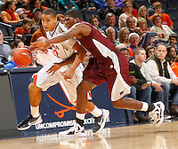 CHARLOTTESVILLE, VA- December 27: Malcolm Brogdon #22 of the Virginia Cavaliers drives past Mark Robertson #31 of the Maryland-Eastern Shore Hawks during the game on December 27, 2011 at the John Paul Jones Arena in Charlottesville, Va. Virginia defeated Maryland Eastern Shore 69-42.  (Photo by Andrew Shurtleff/Getty Images) *** Local Caption *** Malcolm Brogdon;Mark Robertson