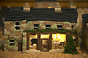 """08/12/16<br /> <br /> Post Office.<br /> <br /> In this incredibly detailed replica of a small Peak District village, everything is edible, from the baubles on the Christmas trees to the flowers around the houses and what's more the """"village"""" is made from 35 individual rich fruit Christmas cakes which will be eaten on the 25th!<br /> <br /> The amazing model village is made up of 18 shops and houses, which are all realistic reproductions of the actual buildings found in Youlgreave, and is open to the public to view at All Saints' church, the main focal point of the miniature masterpiece.<br /> <br /> Retired florist Lynn Nolan, who decorated all the cakes, came up with the original idea as a way of raising money for the church, which needs a new roof, and the first of the cakes went in the oven back in April.<br /> <br /> MORE...https://fstoppressblog.wordpress.com/the-village-thats-really-a-christmas-cake/<br /> <br /> All Rights Reserved F Stop Press Ltd. (0)1773 550665   www.fstoppress.com"""