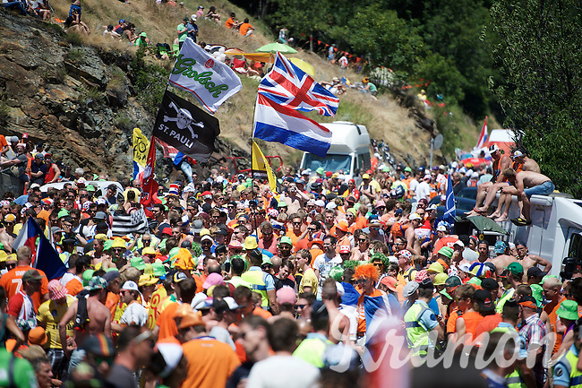 How to get through?Experiencing the craziness at the Dutch Corner (nr7) up Alpe d'Huez 30 minutes before the arrival of the riders<br /> <br /> stage 20: Modane Valfréjus - Alpe d'Huez (111km)<br /> 2015 Tour de France