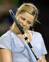 Kim Clijsters bites her racquet in frustration after missing a point duirng her match against Amelie mauresmo  at the Australian Open. Clijsters was forced to retire after injuring her ankle. - pic by Trevor Collens.