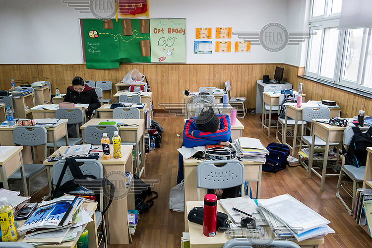 A student catches a quick nap at his deask during a meal break at the Shanghai High School, one of the most exclusive and demanding in the country. Its students academic day often runs from 06:45 to as late as 21:00.