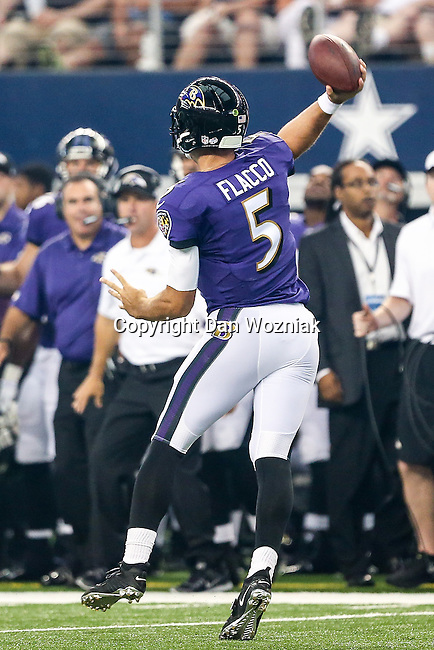 Baltimore Ravens quarterback Joe Flacco (5) in action during the pre-season game between the Baltimore Ravens and the Dallas Cowboys at the AT & T stadium in Arlington, Texas. The Ravens lead Dallas 24 to 10 at half time.
