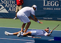 Mardy Fish and Mark Knowles celebrate their win during the Legg Mason Tennis Classic at the William H.G. FitzGerald Tennis Center in Washington, DC.  Mardy Fish and Mark Knowles defeated Tomas Berdych and Radek Stepanek in the doubles final on Sunday afternoon.