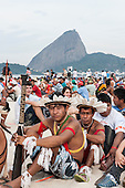 Indigenous people and others are assembling the human banner on Flamengo beach to protest about the construction of hydroelectric dams on Brazil's rivers with the Sugarloaf in the background. The People's Summit at the United Nations Conference on Sustainable Development (Rio+20), Rio de Janeiro, Brazil, 19th June 2012. Photo © Sue Cunningham.