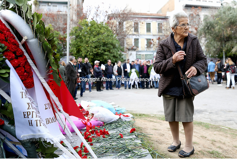 Pictured: A woman pays her respents by the monument of the uprising at the Athens Polytechinc in Athens Greece. Wednesday 16 November 2016<br /> Re: 43rd anniversary of the Athens Polytechnic uprising of 1973 which was a massive demonstration of popular rejection of the Greek military junta of 1967–1974. The uprising began on November 14, 1973, escalated to an open anti-junta revolt and ended in bloodshed in the early morning of November 17 after a series of events starting with a tank crashing through the gates of the Polytechnic.