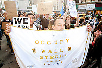 "Thousands of people march up 6th Avenue to Times Square on October 15, 2011 in New York City in support of the ""Occupy Wall Street"" movement."
