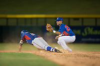 AZL Cubs 2 second baseman Reivaj Garcia (24) shows the ball to the umpire after applying the tag to Ryan Anderson (6) during an Arizona League game against the AZL Rangers at Sloan Park on July 7, 2018 in Mesa, Arizona. AZL Rangers defeated AZL Cubs 2 11-2. (Zachary Lucy/Four Seam Images)