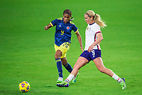 ORLANDO, FL - JANUARY 18: Kena Romero #9 of Colombia and Lindsey Horan #9 of the USWNT battle for the ball during a game between Colombia and USWNT at Exploria Stadium on January 18, 2021 in Orlando, Florida.
