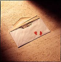Envelope of money with bloody thumbprint on marble background<br />