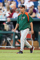Miami Hurricanes head coach Jim Morris walks out of the dugout to talk to his pitcher against the Florida Gators in the NCAA College World Series on June 13, 2015 at TD Ameritrade Park in Omaha, Nebraska. Florida defeated Miami 15-3. (Andrew Woolley/Four Seam Images)