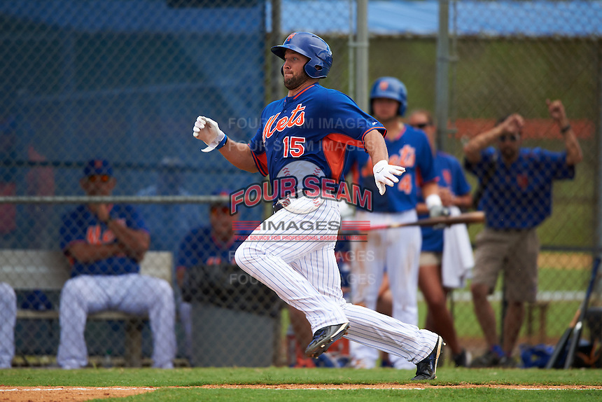 New York Mets outfielder Tim Tebow (15) slides into home during an Instructional League game against the Miami Marlins on September 29, 2016 at Port St. Lucie Training Complex in Port St. Lucie, Florida.  (Mike Janes/Four Seam Images)