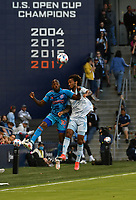 KANSAS CITY, KS - MAY 29: Fafa Picault #10 of Houston Dynamo FC and Gianluca Busio #10 of Sporting KC battle a ball in the air during a game between Houston Dynamo and Sporting Kansas City at Children's Mercy Park on May 29, 2021 in Kansas City, Kansas.