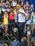 "President Barrack Obama mimics the University of North Florida's mascot osprey and does ""the swoop"" at a Hillary Clinton Vote Early rally in Jacksonville, Fla., Thursday, Nov. 3, 2016.  (AP Photo/Mark Wallheiser)"