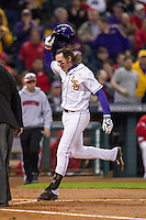 LSU Tigers third baseman Conner Hale (20) crosses the plate after hitting a 2 run home run during the NCAA baseball game against the Houston Cougars on March 6, 2015 at Minute Maid Park in Houston, Texas. LSU defeated Houston 4-2. (Andrew Woolley/Four Seam Images)