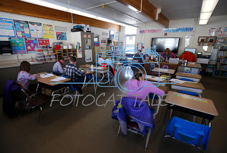 Students work on a recent art lesson in the one-room schoolhouse in Ruby Valley. The rural school is one of the many served by Nevada bookmobiles. <br /> Photo by Cathleen Allison/Nevada Momentum