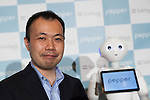 Kenichi Yoshida, vice president of business development for SoftBank Robotics and robot Pepper pose for a photograph at Pepper for Biz 2.0 on July 20, 2016, Tokyo, Japan. Yoshida along with other guests spoke about the new features of Pepper such as Chinese response and speech recognition, and duty free tax refunds and electronic payments services, in response to business needs. The presentation was held a day before the start of Pepper World 2016 exhibition, where developers will introduce applications for SoftBank's robot Pepper. Pepper World will run until July 22. (Photo by Rodrigo Reyes Marin/AFLO)