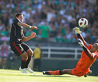 Pasadena, CA - June 25, 2011: Javier Hernandez shoots on goal as Tim Howard defends, United States vs Mexico in the 2011 CONCACAF Gold Cup Championships, at the Rose Bowl. Mexico won 4-2.