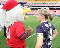 Cat Whitehill #4 of the Washington Freedom discusses tactics with Glory during a WPS match against ST. Louis Athletica on May 1 2010, at RFK Stadium, in Washington D.C. Freedom won 3-1.