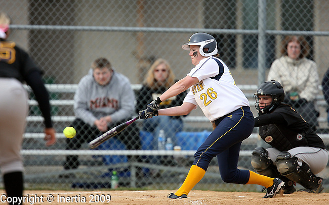 SIOUX FALLS, SD - APRIL 10:  Ally Rutherford #26 of Augustana slaps a base hit  against Northern State in the second game of their doubleheader Friday afternoon at Bowden Field. (Photo by Dave Eggen/Inertia)