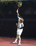 Tennis action photography. Player serves.