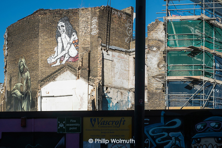 Murals on a partially demolished building in Hoxton, London.  The area is undergoing intensive redevelopment, with new residential and office blocks squeezing out Silicon Roundabout tech start-ups and other small businesses.