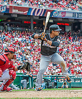 22 September 2013: Miami Marlins infielder Donovan Solano in action against the Washington Nationals at Nationals Park in Washington, DC. The Marlins defeated the Nationals 4-2 in the first game of their day/night double-header. Mandatory Credit: Ed Wolfstein Photo *** RAW (NEF) Image File Available ***