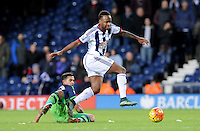 Saido Berahino of West Bromwich Albion tackled by Kyle Naughton of Swansea City during the Barclays Premier League match between West Bromwich Albion and Swansea City at The Hawthorns on the 2nd of February 2016