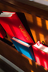 Red and blue books of worship in a church pew