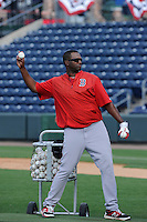 Pitching coach Walter Miranda (44) of the Greenville Drive throws batting practice during a preseason workout on  Wednesday, April 8, 2015, the day before Opening Day, at Fluor Field at the West End in Greenville, South Carolina. (Tom Priddy/Four Seam Images)
