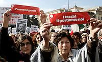 """""""Se non ora quando?"""": manifestazione contro il presidente del consiglio, per il rispetto della dignita' e dei diritti delle donne, a Roma, 13 febbraio 2011..Women attend the """"If not now, when?"""" rally against the Italian premier, to ask for respect of their dignity and rights, in Rome, 13 february 2011..The signs read """"Love is for free"""" , left, and """"That's us who put high-heels on""""..UPDATE IMAGES PRESS/Riccardo De Luca"""