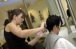 .Hairdresser cuts hair in Salon..Photo by Alan Edwards©.